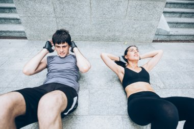 sportive Couple doing abdominal