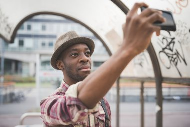 man taking a selfie on smart phone
