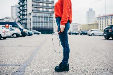 woman listening music with earphones