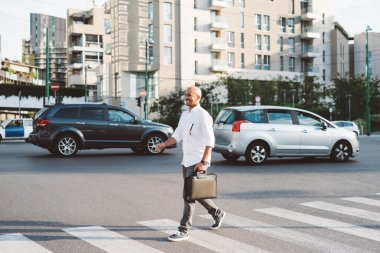 business man walking on pedestrian crossing