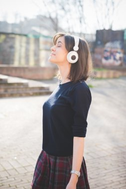 Girl listening music with headphones