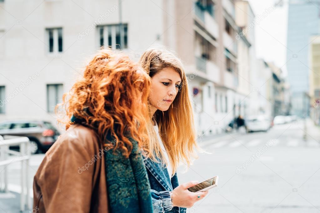 women friends strolling outdoor
