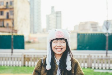asiatic hipster woman in city