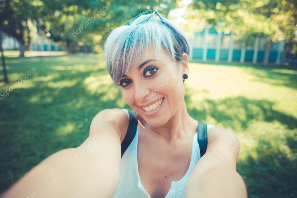 young beautiful short blue hair hipster woman selfie