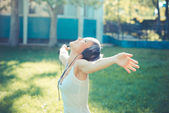 Fotografie Hipster woman with headphones music