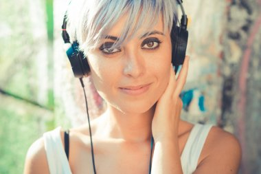 Hipster woman with headphones music