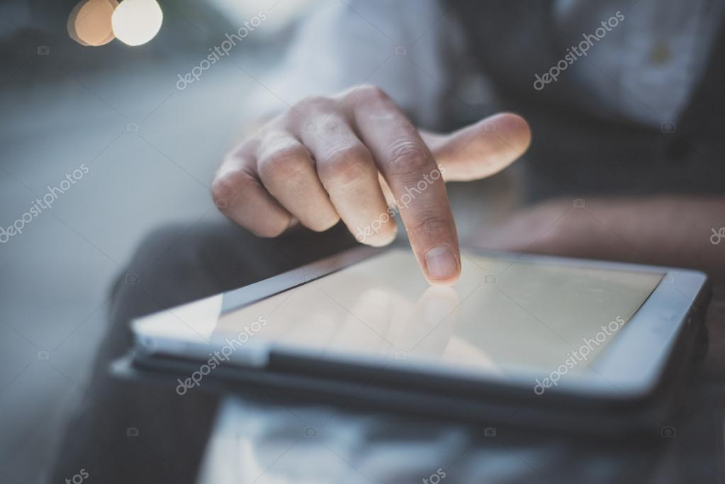 handsome big moustache hipster man using tablet