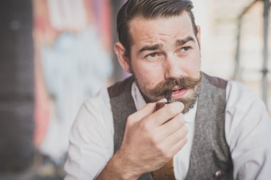 Man with big moustache smoking pipe