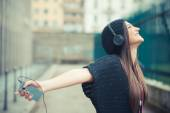 Fotografie Crazy brunette woman listening music