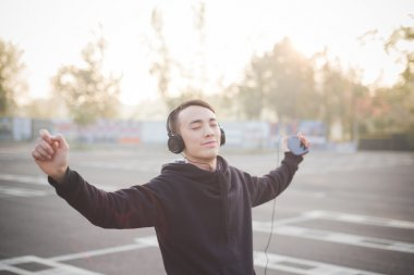 Young asian man in headphones dancing