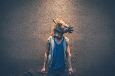 hipster gay man in horse mask