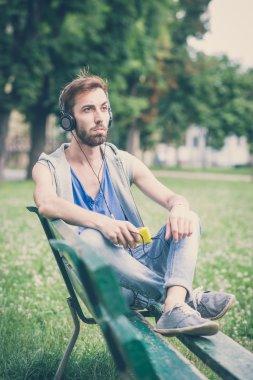 hipster gay man listening music