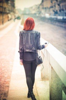 young beautiful red hair venezuelan woman lifestyle listening mu