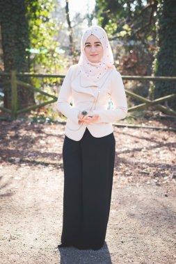 Young muslim woman in  park