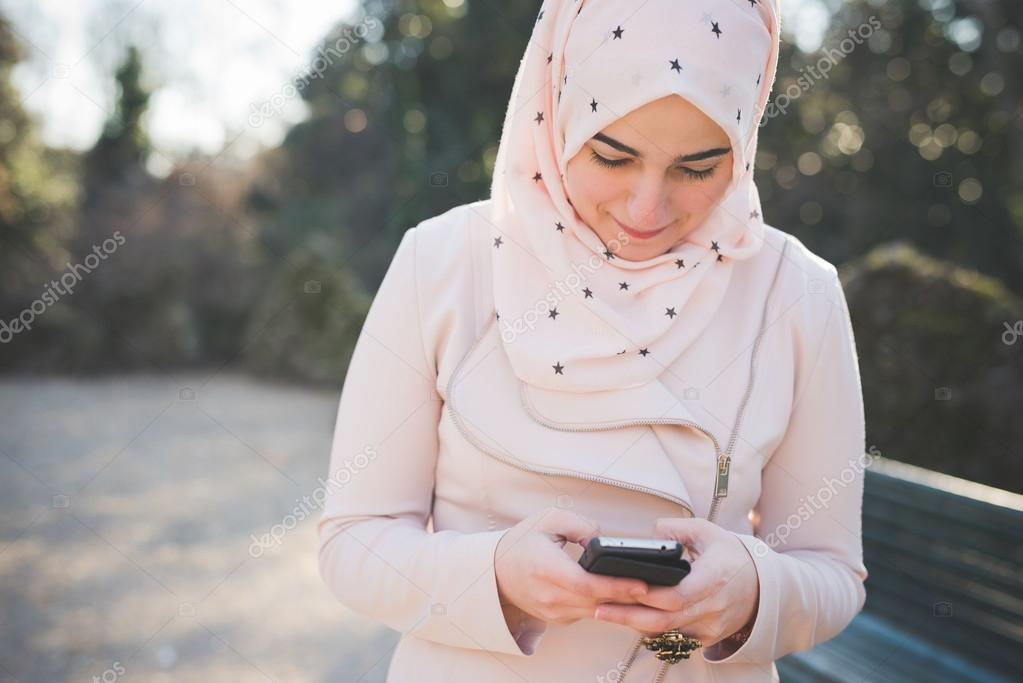 Muslim woman with smartphone