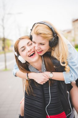 two girls listening music