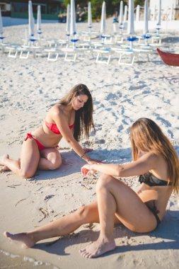 friends on beach in summer