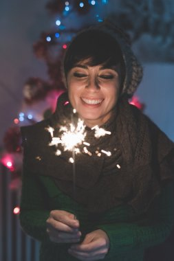 woman celebrating holding a sparkler