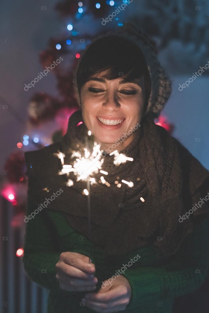 woman celebrating holding a sparkler