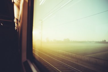 countryside view by a train window