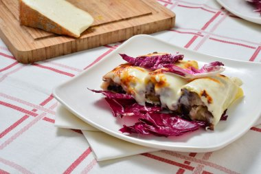 Cannelloni with radicchio and Taleggio cheese fondue