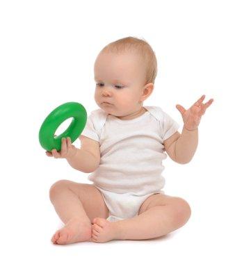 Infant child baby boy toddler playing holding green circle