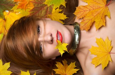 Fashion woman smiling joyful holding autumn yellow maple leaf in