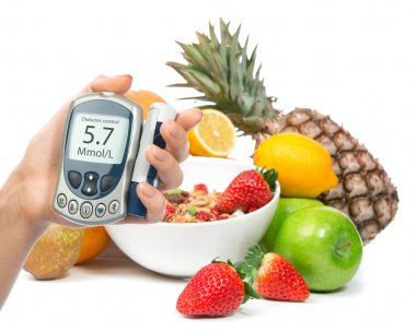 Diabetes diabetic concept glucose meter in hand and healthy orga