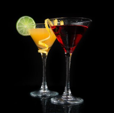 Two cocktails red cosmopolitan cocktail on a black background