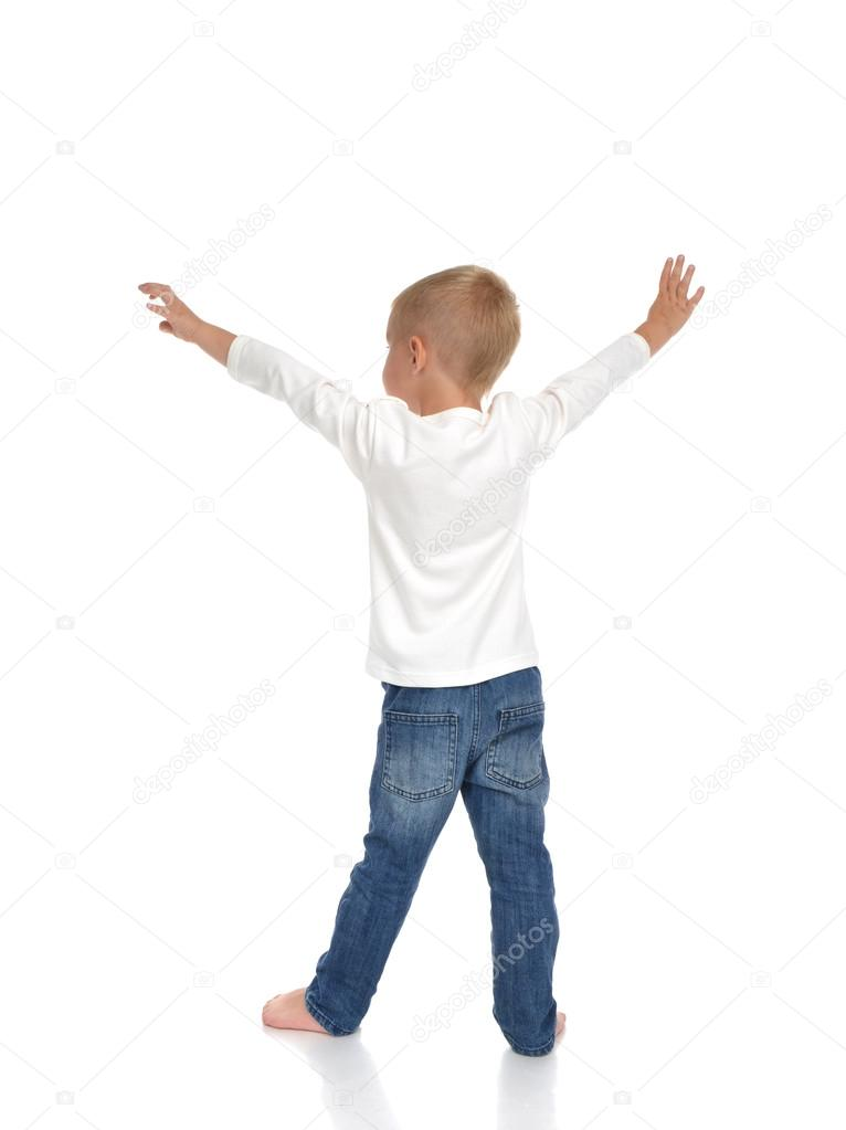 Rear view baby boy kid with arms open feeling freedom and happin