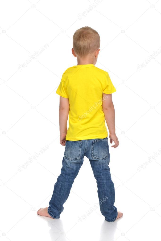 Rear view of caucasian full body american baby boy kid in yellow