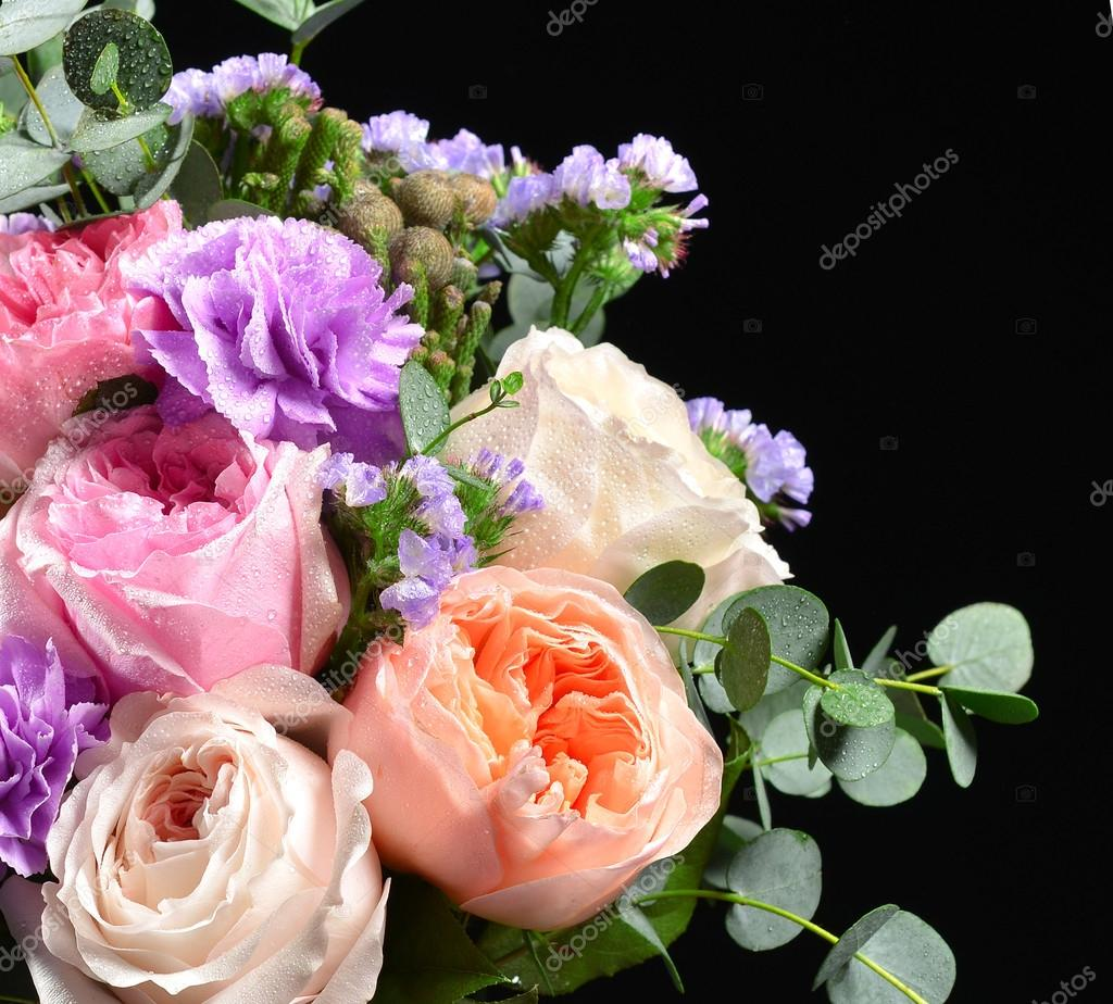 Beautiful bouquet of bright white pink purple roses flowers with