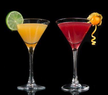 Two cocktails cosmopolitan cocktails decorated with citrus lemon