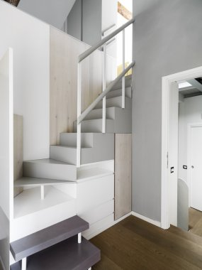 wood modern staircase in the apartment