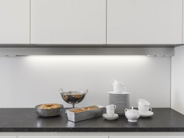 dishes and cakes  on the worktop in the modern kitchen