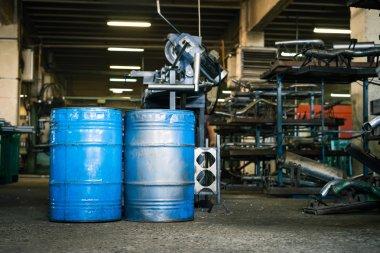 two blue industrial barrels