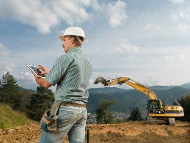 architect checking construction progress