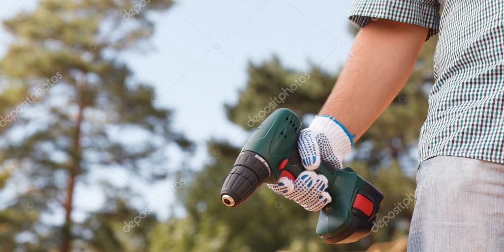 man holding electric drill