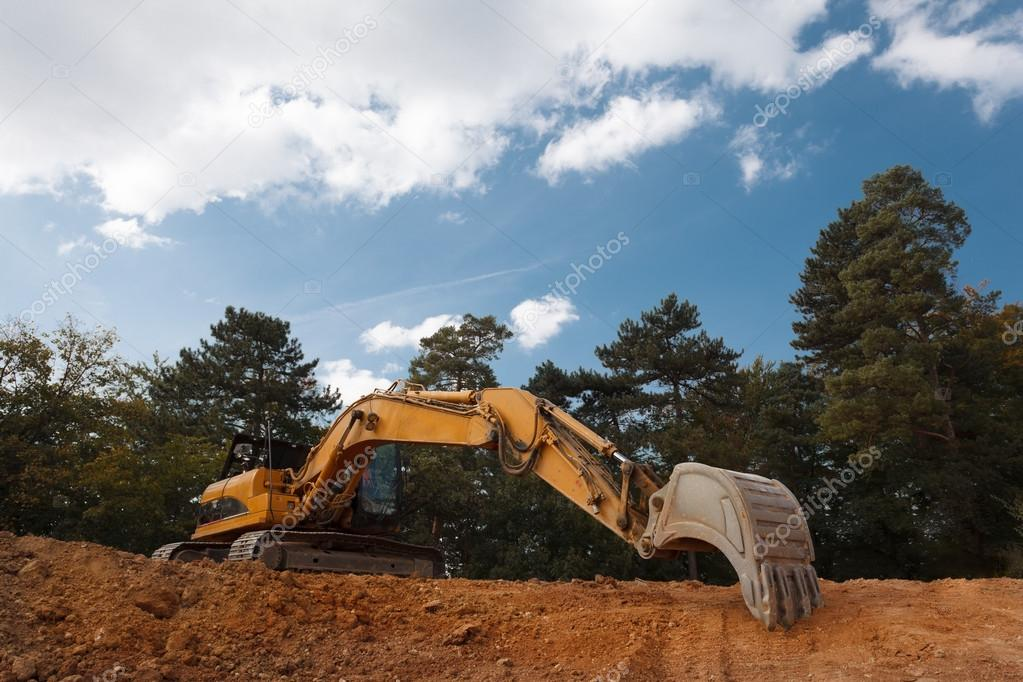 excavator digging on construction site