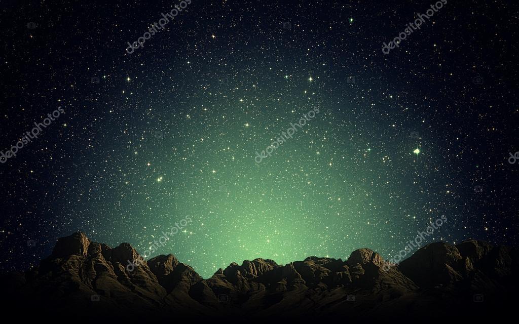 Night sky above rocky mountains