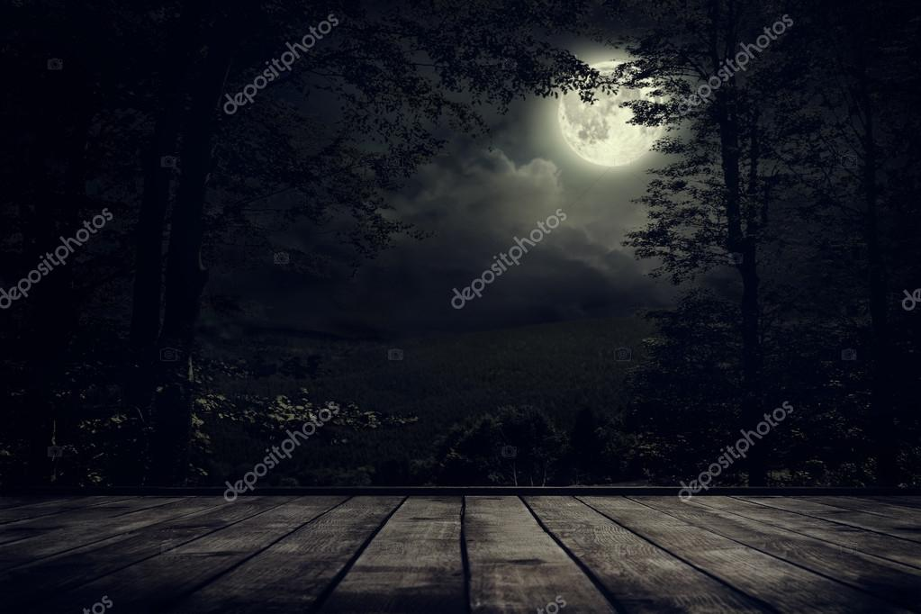 Night mountains landscape with moon light.