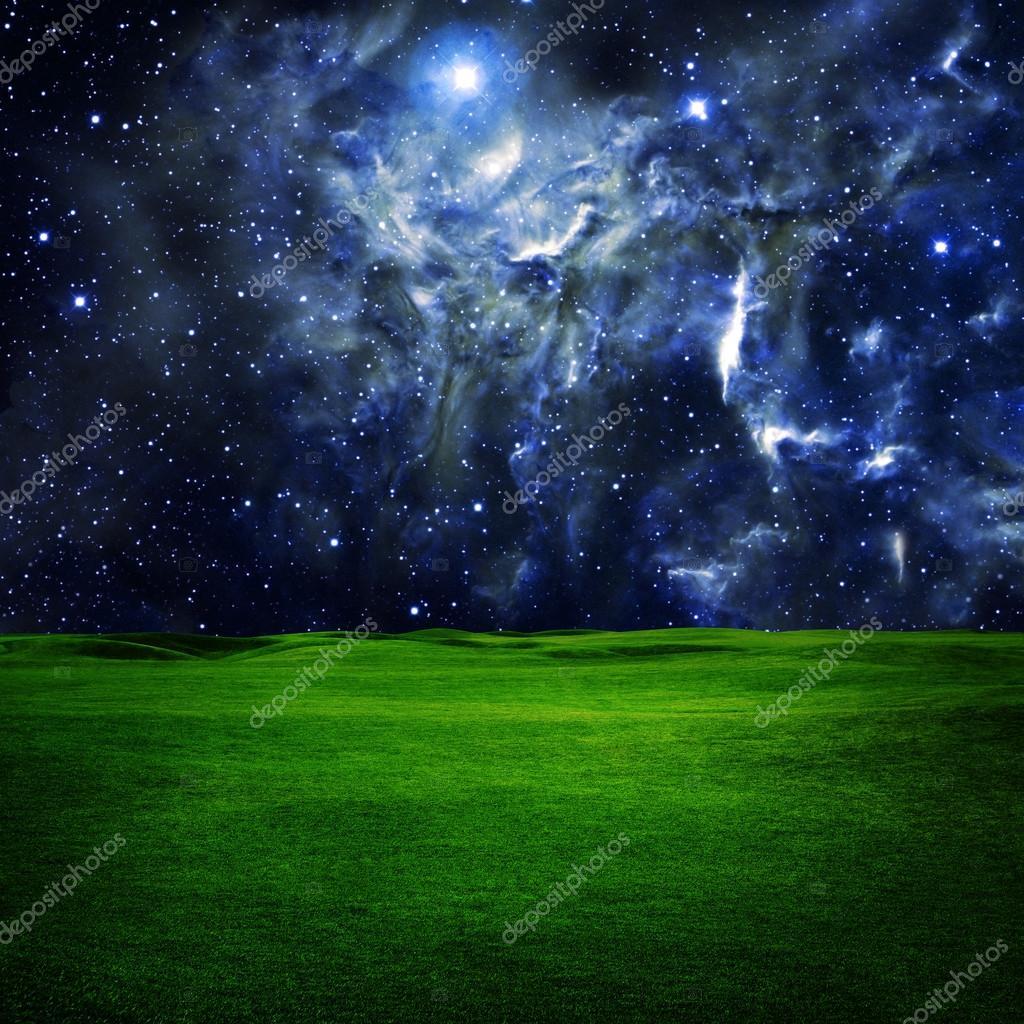 Green field under night sky
