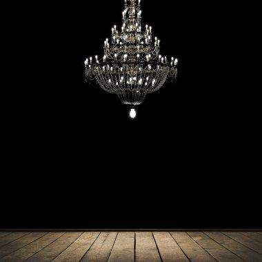 Dark room with chandelier