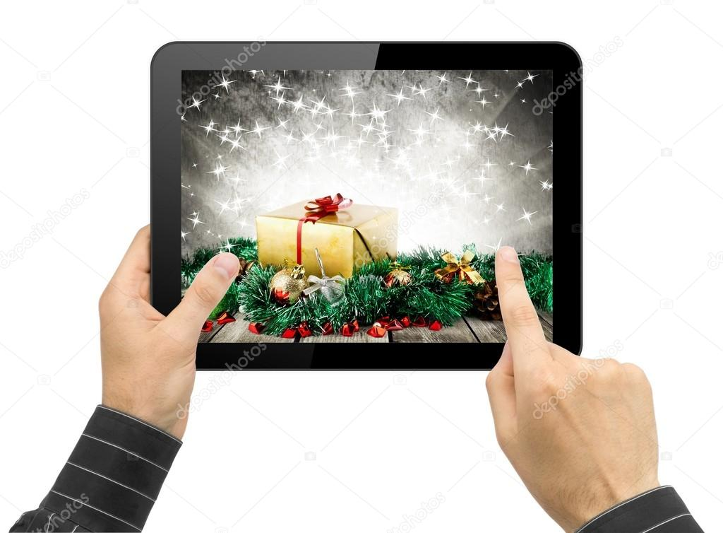 Black Tablet Pc Like Ipade In Hands With Christmas Wallpaper Choosing Gift Concept Photo By Robertsrob