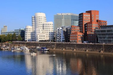 DUSSELDORF, GERMANY - SEPTEMBER 19, 2020: Neuer Zollhof modern architecture in Dusseldorf, Germany. The residential complex was designed by American architect Frank Gehry in 1998.