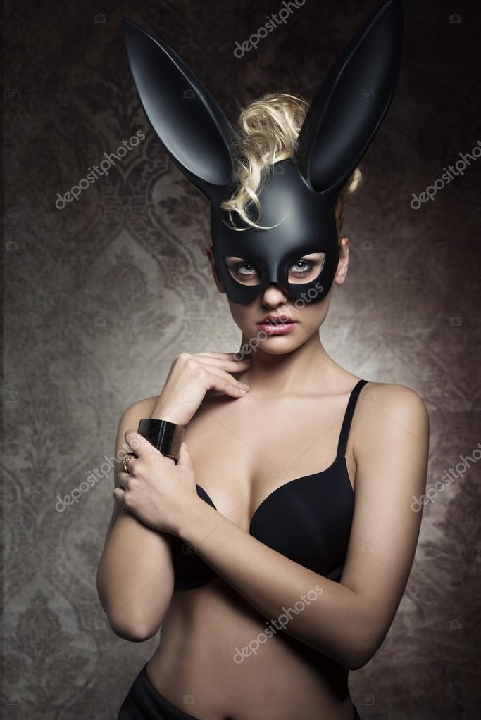 charming girl with bizarre bunny mask