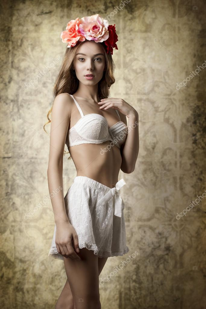 af847aae3b Beautiful woman with spring flowers on the head and vintage lingerie posing  with romantic expression and natural make-up — Photo by carlodapino