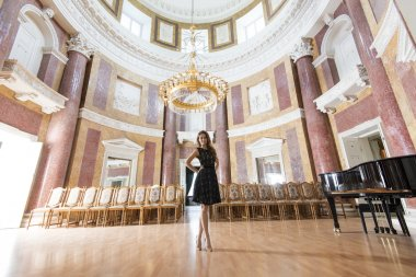 elegant woman in concert hall