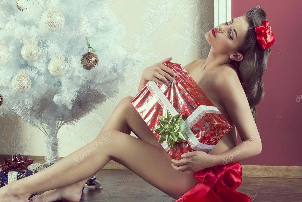 erotic female with xmas gift