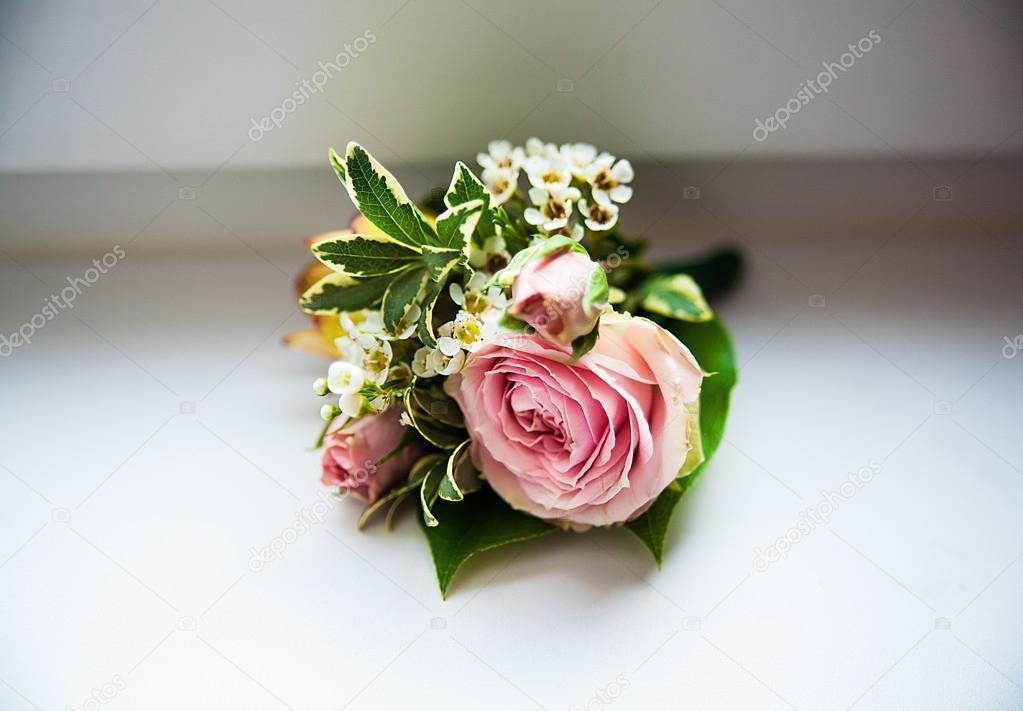 Grooms boutonniere of roses